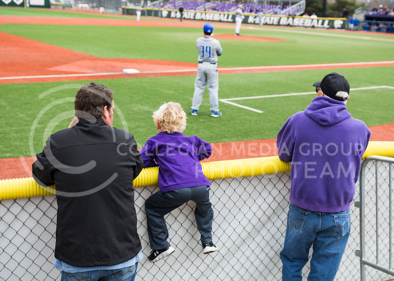 Attendees watch the K-State baseball game against Eastern Illisnois University at Tointon Family Stadium on Mar. 5, 2017. (John Benfer | The Collegian)