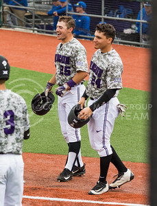 Senior Josh Ethier and Sophomore Josh Rolette walk back to their dugout after scoring in their game against Eastern Illisnois University at Tointon Family Stadium on Mar. 5, 2017. (John Benfer | The Collegian)