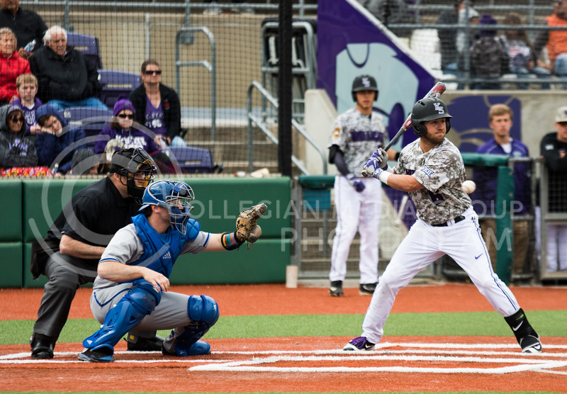 Senior infielder Josh Ethier takes a ball while batting at the K-State baseball game against Eastern Illisnois University at Tointon Family Stadium on Mar. 5, 2017. (John Benfer | The Collegian)