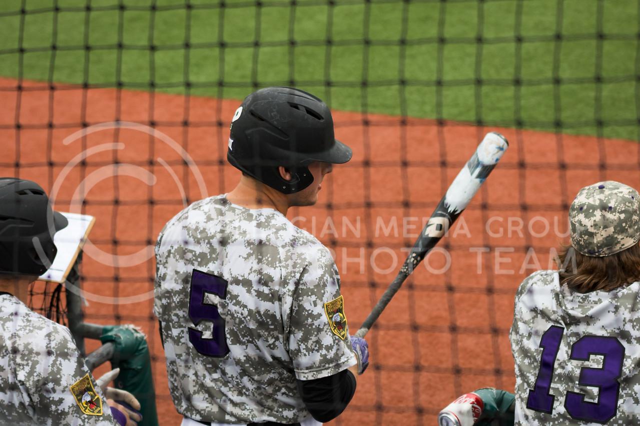 Sophomore infielder Grant Reuben prepares to bat at the K-State baseball game against Eastern Illisnois University at Tointon Family Stadium on Mar. 5, 2017. (John Benfer | The Collegian)