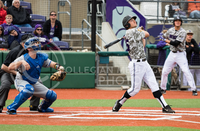 Senior infielder Quintin Crandall hits the ball while at bat during the K-State baseball game against Eastern Illisnois University at Tointon Family Stadium on Mar. 5, 2017. (John Benfer | The Collegian)