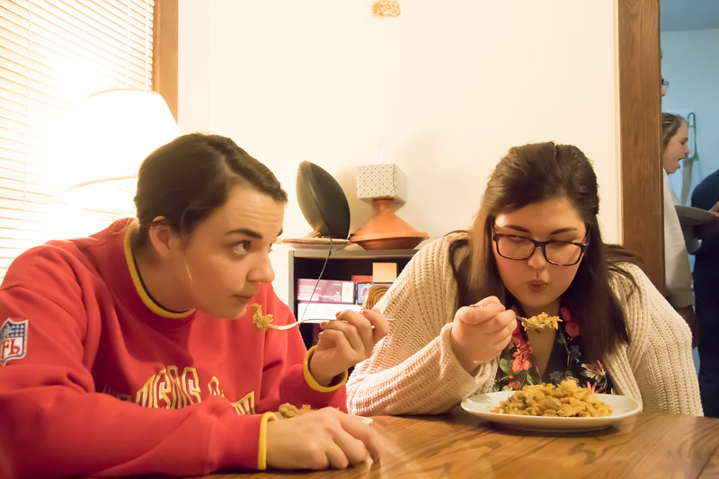 Helene Waldeck (left), junior in family studies and human services, and Haley Hannaman, graduate student in student development, eat Sri Lankan food at Eating Around the World on Sunday, Feb. 25, 2018, in a house on Laramie Street near the Kansas State University campus. (Tiffany Roney | Collegian Media Group)