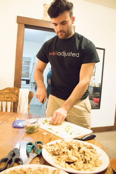 Ramin Rostampour, senior in civil engineering, chops veggies for Sri Lankan food at Eating Around the World on Sunday, Feb. 25, 2018, in his house. (Tiffany Roney | Collegian Media Group)