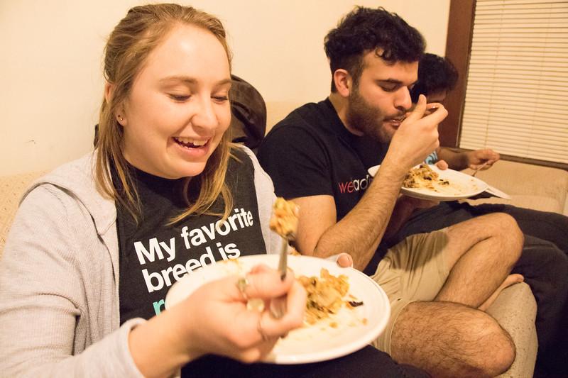 Kansas State University students eat Sri Lankan food at Eating Around the World on Sunday, Feb. 25, 2018, in a house on Laramie Street near campus. (Tiffany Roney | Collegian Media Group)