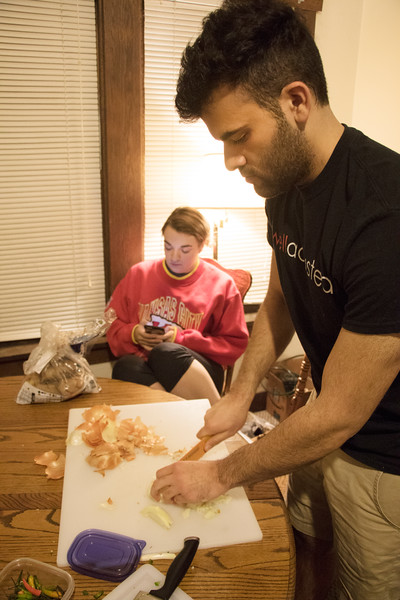 Ramin Rostampour, senior in civil engineering, chopes onions for Sri Lankan food at Eating Around the World on Sunday, Feb. 25, 2018, in his house. Also pictured: Helene Waldeck, junior in family studies and human services. (Tiffany Roney | Collegian Media Group)