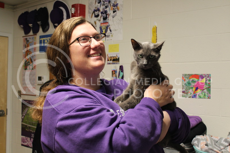 Dice, freshman in blog, holds her cat Jill inside her dorm. Jill is a certified Emotional Support Animal and having her around helps Dice deal with past trauma. Emily Eubank