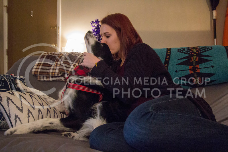 Alyssa Arnsperger, sophomore studying Animal Science Pre-Vet with a minor in Business snuggles with her dog Milo to destress. (Sabrina Cline | Collegian Media Group)