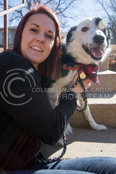 Alyssa Arnsperger, sophomore studying Animal Science Pre-Vet with a minor in Business poses for a picture with her dog Milo outside while they're playing. (Sabrina Cline | Collegian Media Group)