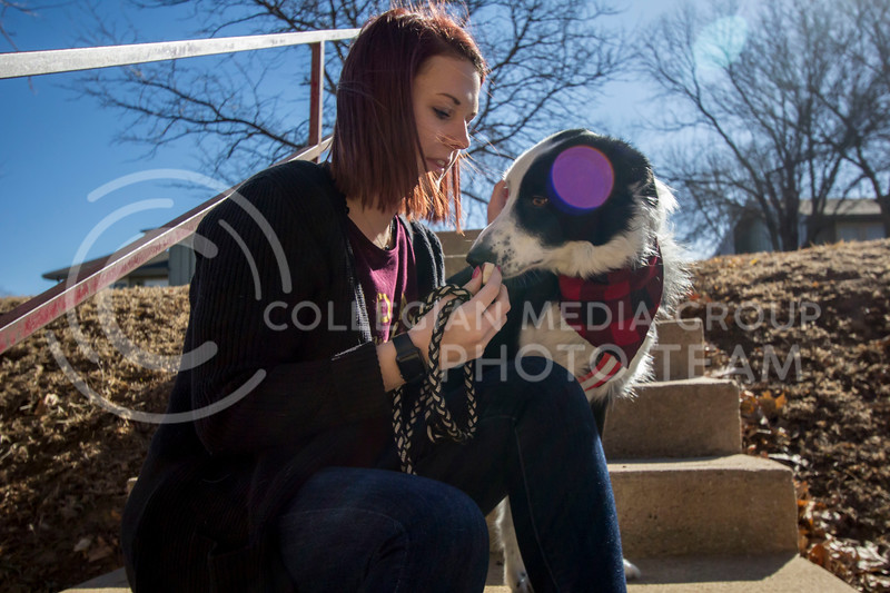 Alyssa Arnsperger, sophomore studying Animal Science Pre-Vet with a minor in Business gives her dog Milo a treat after performing a trick. (Sabrina Cline | Collegian Media Group)