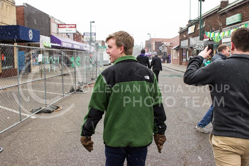 Andrew Young walks through Aggieville on Fake Patty's Day. (Regan Tokos | The Royal Purple)