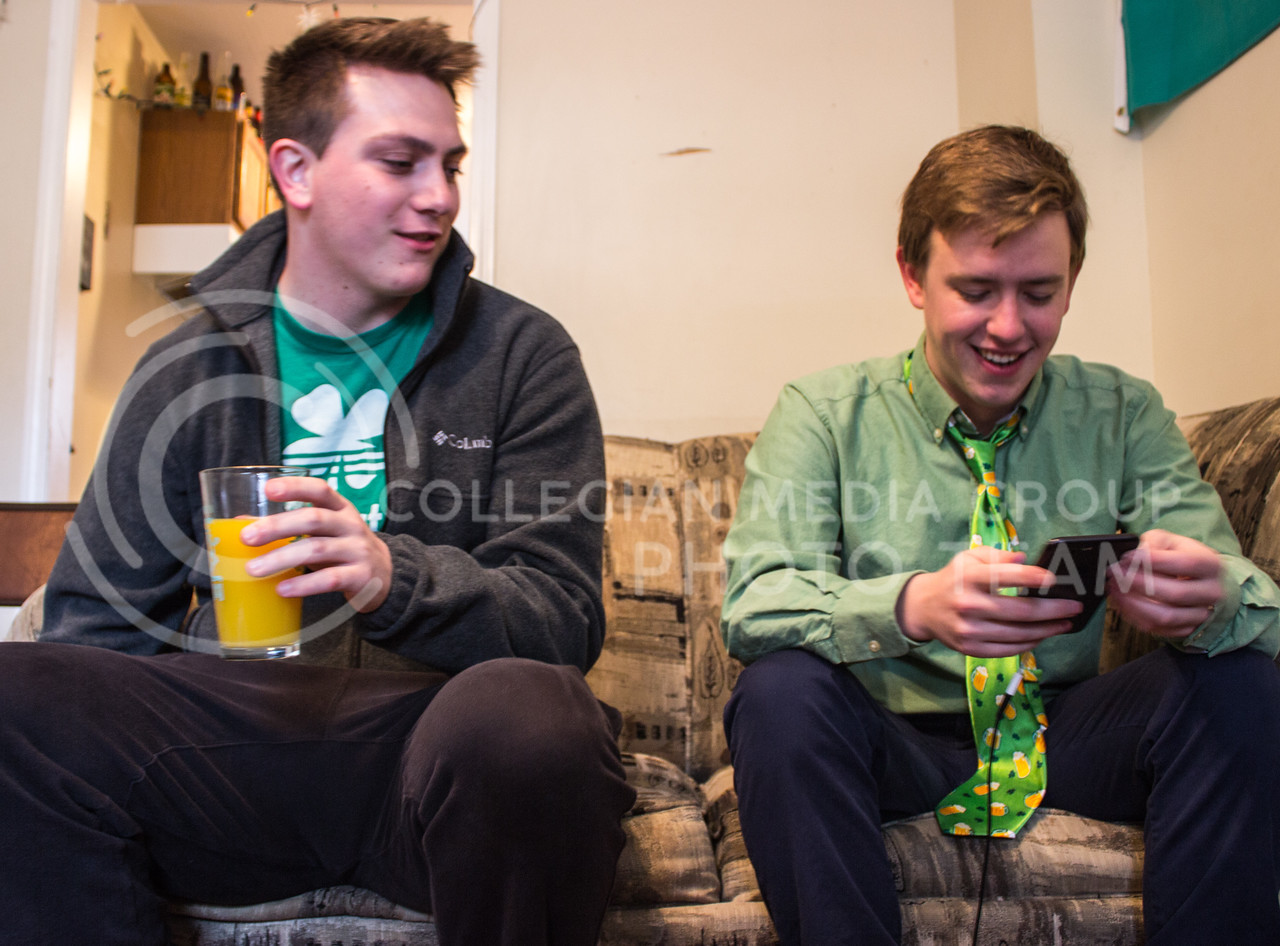 Scott Perlenfein, senior in industrial engineering, and Andrew Young, junior in regional and community planning, start off the morning of Fake Patty's Day with mimosas. (Regan Tokos | The Royal Purple)