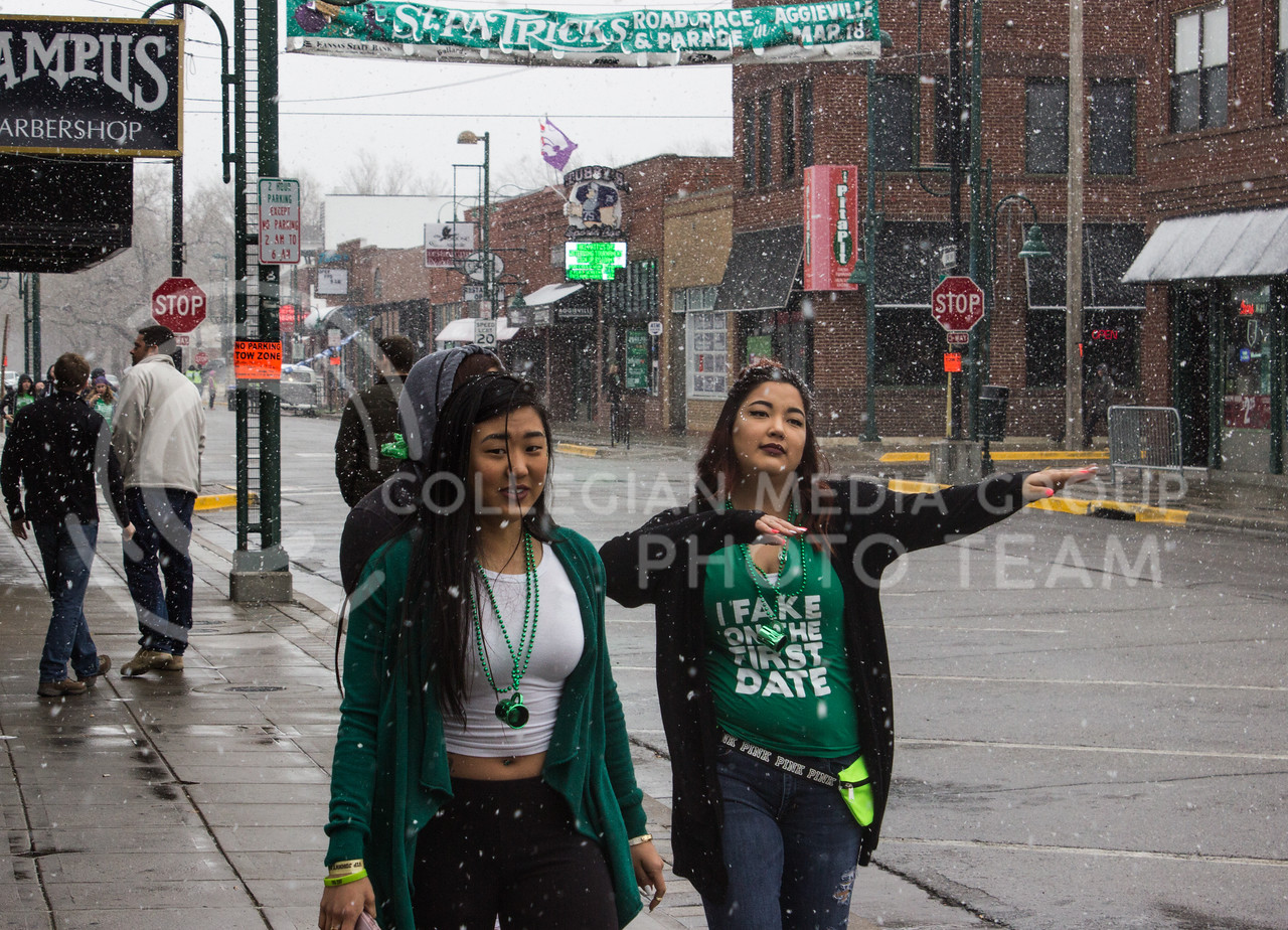Students walk down Moro Street in Aggieville through the snow to get to the bars on the morning of Fake Patty's Day. (Regan Tokos | The Royal Purple)