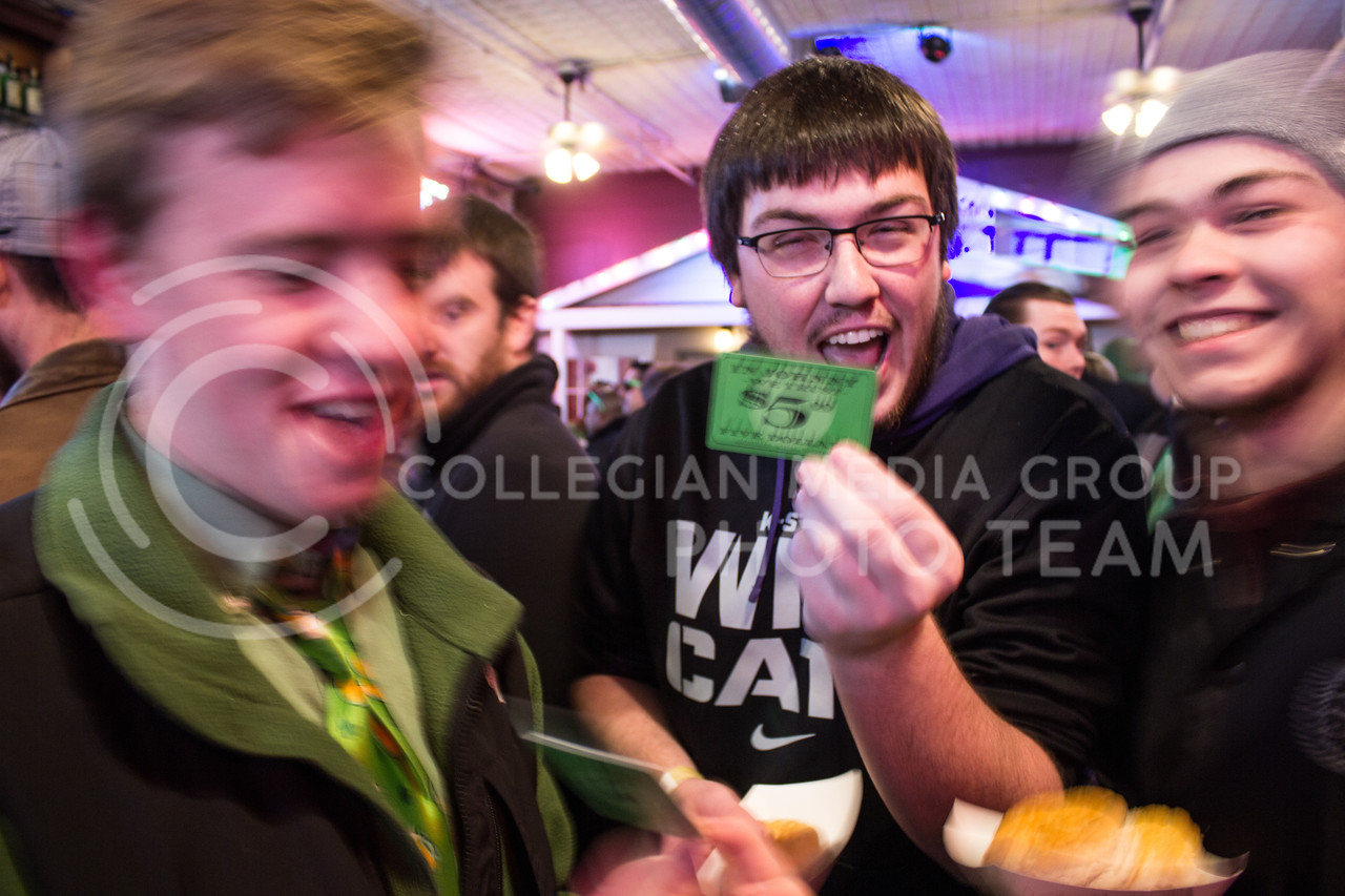 Joe Wilmes, senior in regional and community planning, shows off a five dollar gift card he recieved from Johnny Kaw's on the morning of Fake Patty's Day. (Regan Tokos | The Royal Purple)