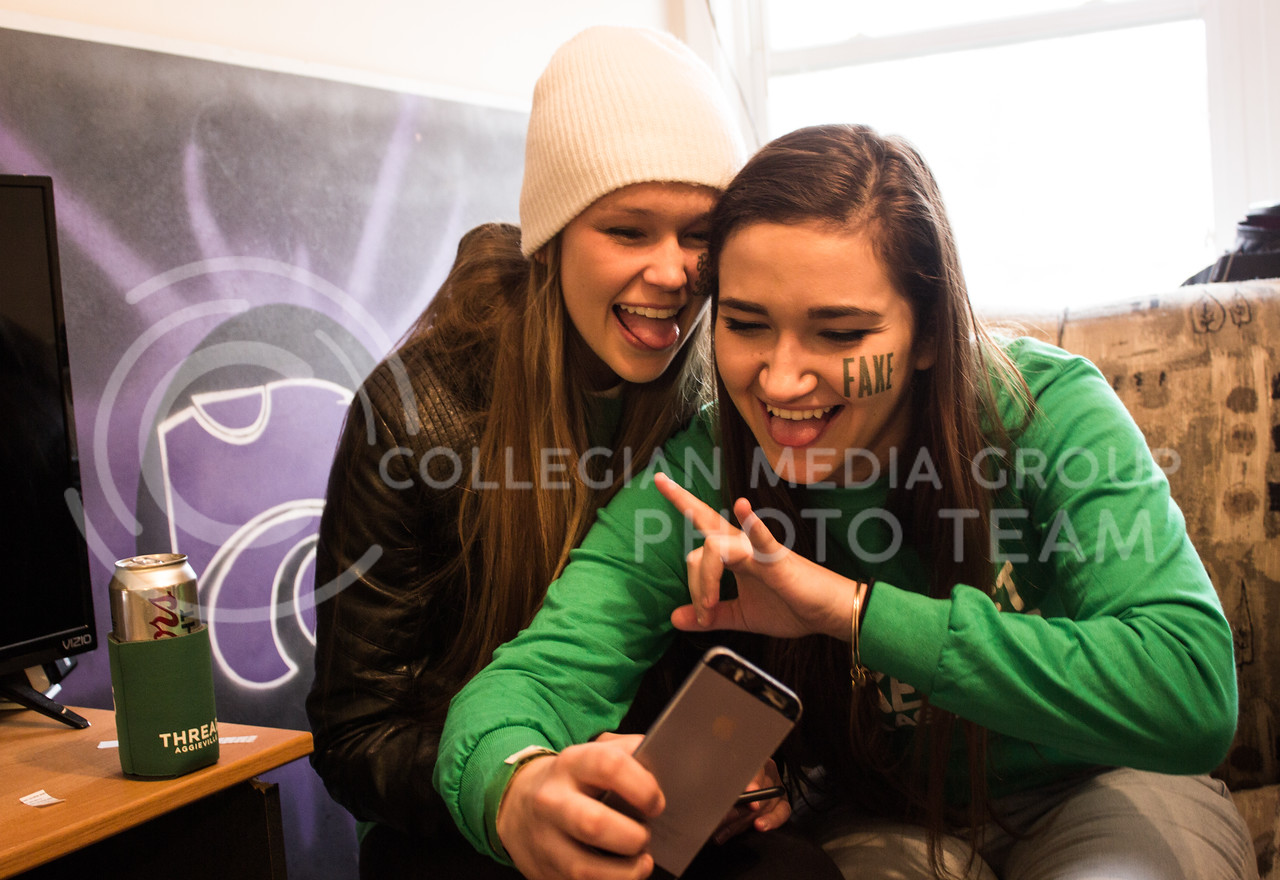 Heather Cobbs, graduate student in architecture, takes a selfie with her friend on the morning of Fake Patty's Day before heading to Aggieville. (Regan Tokos | The Royal Purple)