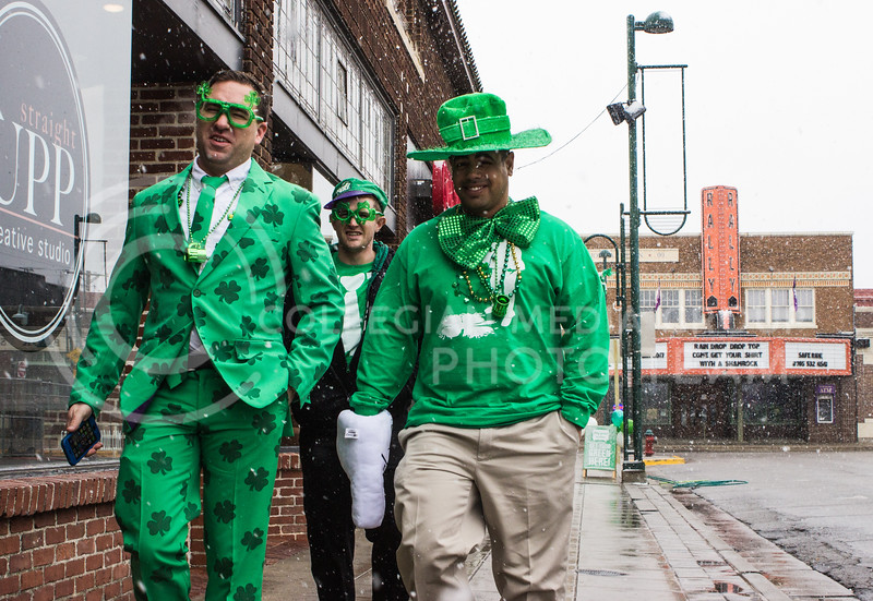 Fake Patty's Day participants walk down Moro Street in Aggieville through the snow to get to the bars on the morning of Fake Patty's Day. (Regan Tokos   The Royal Purple)