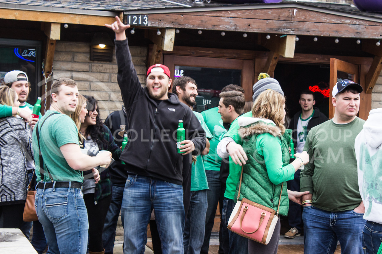 Participants in the 2017 Fake Patty's Day festivities cheer outside of Rusty's. (Regan Tokos | The Royal Purple)