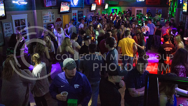 Bar goers at Johhny Kaws Sports Bar in Aggieville listen to music and dance on March 4, 2016.  (Photo by Miranda Snyder | The Collegian)