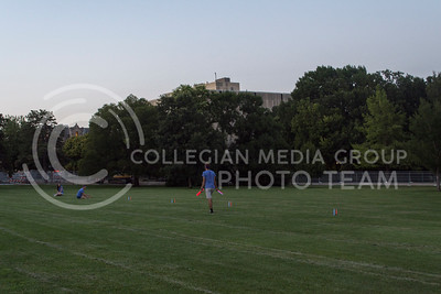 JMC students help out with setting up the game of capture the flag. (Sarah Falcon | The Collegian)