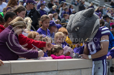 Wille signs items for fans during the Spring Game in Bill Snyder Family Stadium on Apr. 22, 2017. (Nathan Jones | The Collegian)