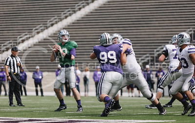 Redshirt freshman quarterback Skylar Thompson drops back in the pocket during the spring game in Bill Snyder Family Stadium on April 22, 2017. (Emily Starkey | The Collegian)