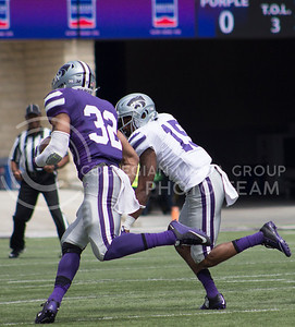 Sophomore running back Justin Silmon runs down the field at the Spring Game at Bill Snyder Family Stadium on April 22, 2017. (Kelly Pham | The Collegian)