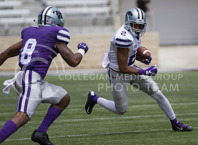 Sophomore wide receiver Isaiah Harris runs the ball down the field during the Spring Game in Bill Snyder Family Stadium on Apr. 22, 2017. (Nathan Jones | The Collegian)
