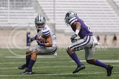 Sophomore wide receiver Corey Sutton runs the ball during the spring game in Bill Snyder Family Stadium on April 22, 2017. (Emily Starkey | The Collegian)
