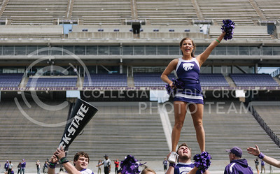 The K-State cheerleaders cheer during the spring game in Bill Snyder Family Stadium on April 22, 2017. (Emily Starkey | The Collegian)