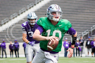 Freshman quarterback Skylar Thompson runs the ball during the spring game in Bill Snyder Family Stadium on Apr. 22, 2017 (Maddie Domnick | The Collegian)