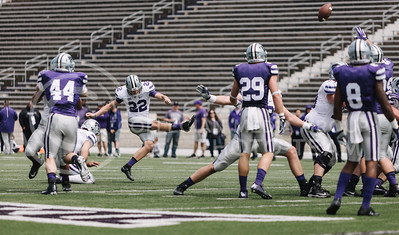 Sophomore punter Nick McLellan kicks during the spring game in Bill Snyder Family Stadium on April 22, 2017. (Emily Starkey | The Collegian)
