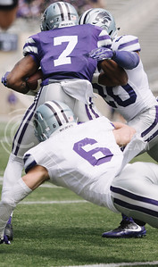 Sophomore wide receiver Isaiah Zuber gets tackled during the spring game in Bill Snyder Family Stadium on April 22, 2017. (Emily Starkey | The Collegian)