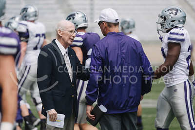 Head football coach Bill Snyder talks to an assistant coach during the spring game in Bill Snyder Family Stadium on April 22, 2017. (Emily Starkey | The Collegian)
