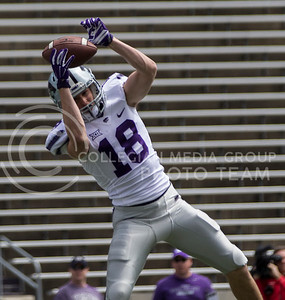 Player catches the ball during the Spring Game in Bill Snyder Family Stadium on Apr. 22, 2017. (Nathan Jones | The Collegian)