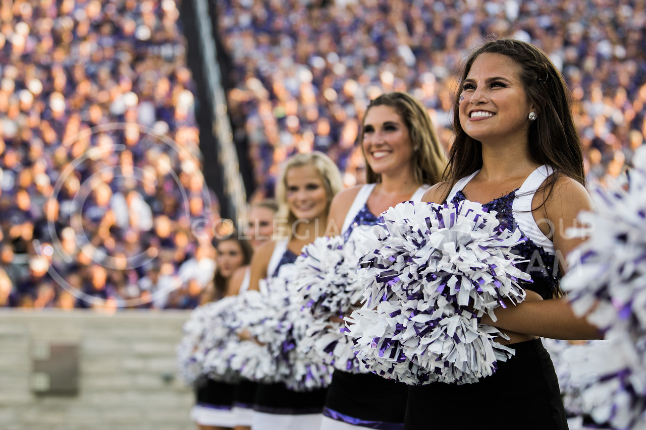 Kansas State cheerleaders watch the kickoff at the football game between K-State and Central Arkansas in Bill Snyder Family Stadium on Sept. 2, 2017. (Meg Shearer | Collegian Media Group)