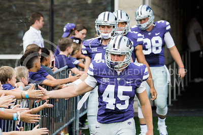 Kansas State football players prepare to take the field at the start of the football game between K-State and Central Arkansas in Bill Snyder Family Stadium on Sept. 2, 2017. (Meg Shearer | Collegian Media Group)