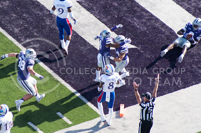 Freshman running back Alex Barnes scores a touchdown against KU during the Sunflower Showdown on Nov. 26, 2016. The Cats won 34-19. (Evert Nelson | The Collegian)