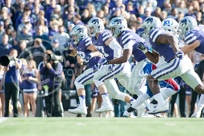 The Wildcats' defense charges after KU in hopes of blocking a punt during the Sunflower Showdown on Nov. 26, 2016, in Bill Snyder Family Stadium. The Cats won 34-19. (Evert Nelson | The Collegian)