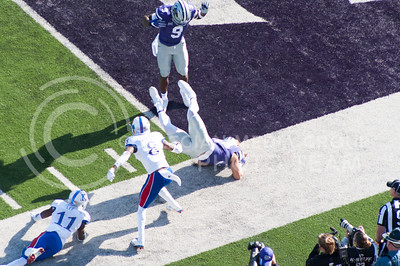 Freshman running back Alex Barnes leaps over KU players to score a touchdown during the Sunflower Showdown on Nov. 26, 2016. The Cats won 34-19. (Evert Nelson | The Collegian)