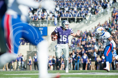 Junior quarterback Jesse Ertz runs the ball away from KU defenders during the Sunflower Showdown in Bill Snyder Family Stadium on Nov. 26, 2016. The Cats won 34-19. (Evert Nelson | The Collegian)