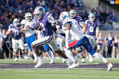 Sophomore wide receiver Byron Pringle runs through the KU defense during the Sunflower Showdown on Nov. 26, 2016, in Bill Snyder Family Stadium. The Cats won 34-19. (Evert Nelson | The Collegian)