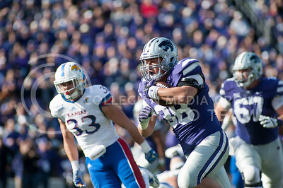 Sophomore fullback Winston Dimel runs the ball during a play against KU at the Sunflower Showdown on Nov. 26, 2016, in Bill Snyder Family Stadium. The Cats won 34-19. (Evert Nelson | The Collegian)