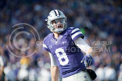 Senior quarterback Joe Hubener shouts out to teammates before a play against KU during the Sunflower Showdown in Bill Snyder Family Stadium on Nov. 26, 2016. The Cats won 34-19. (Evert Nelson | The Collegian)