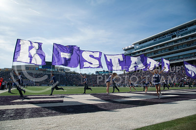 The K-State flags run across the field after a touchdown against KU during the Sunflower Showdown on Nov. 26, 2016. The Cats won 34-19. (Evert Nelson | The Collegian)