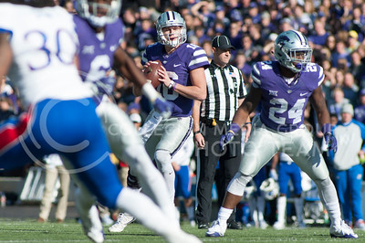 Junior quarterback Jesse Ertz looks for open players during the football game between K-State and KU during the Sunflower Showdown on Nov. 26, 2016. The Cats won 34-19. (Evert Nelson | The Collegian)