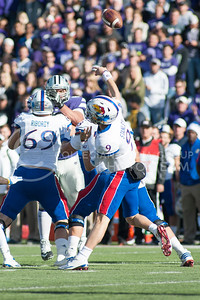 KU quarterback Carter Stanley launches the ball over K-State defenders during the Sunflower Showdown on Nov. 26, 2016, in Bill Snyder Family Stadium. The Cats won 34-19. (Evert Nelson | The Collegian)