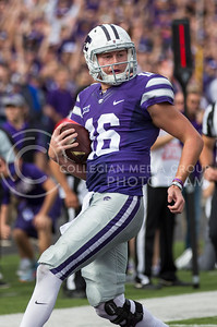 Junior quarterback Jesse Ertz runs the ball into the endzone during the K-State football game against Oklahoma State in Bill Snyder Family Stadium on Nov. 5, 2016. (Nathan Jones | The Collegian)
