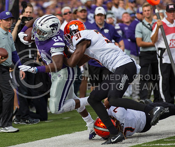 Senior running back Charles Jones tries to evade the defense during the K-State football game against Oklahoma State in Bill Snyder Family Stadium on Nov. 5, 2016. (Nathan Jones | The Collegian)