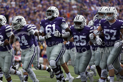 The K-State football team runs off the field after warming up in their new uniforms during the football game against Oklahoma State in Bill Snyder Family Stadium on Nov. 5, 2016. (Nathan Jones | The Collegian)