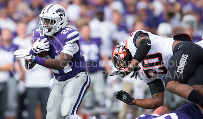 Senior running back Charles Jones avoids Oklahoma State defense during the game between K-State and Oklahoma State in Bill Snyder Family Stadium on Nov. 5, 2016. (George Walker | The Collegian)