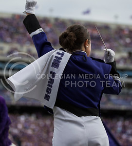A drum major of The Pride of Wildcat Land conducts the pregame show of the football game between K-State and Oklahoma State in Bill Snyder Family Stadium on Nov. 5, 2016. (Nathan Jones | The Collegian)